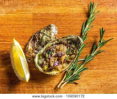 Salad in oyster served with greens and lemon