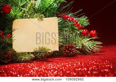 Christmas tree branches with blank note