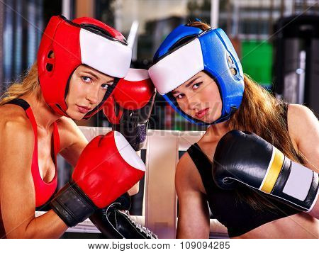 Portrait of couple   women boxer wearing red  gloves to box in ring.