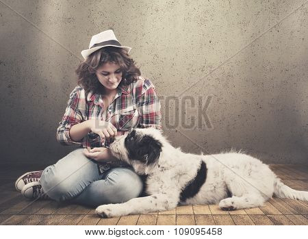 Young Girl Relaxes With Her Dog