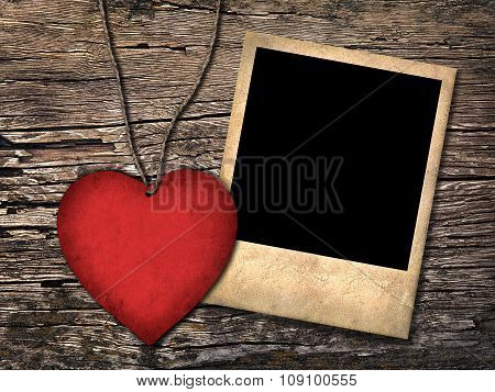 Red Paper Heart And Old Photo  On The Wooden Background