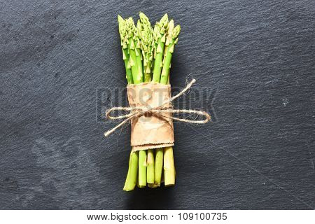 Bunch of asparagus over slate background