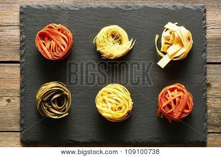 Pasta tagliatelle set over slate background