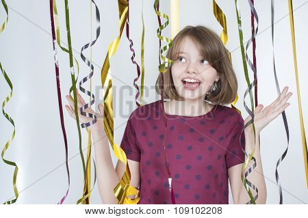 Portrait Of Joyful Girl Among Multicolored Ribbons..