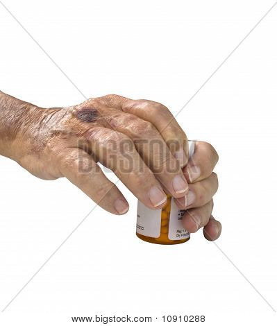 Elderly Male Hand With Arthritis Holding Pills