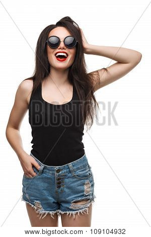 Fashion lifestyle portrait of young happy pretty woman laughing and having fun on the street at nice