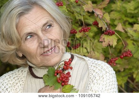 senior woman in  viburnum