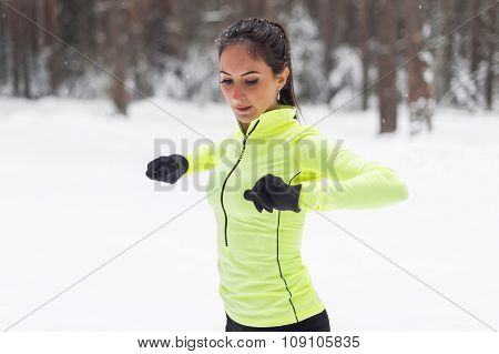 Fit woman warming up before a morning workout.