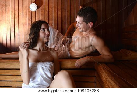 Couple In Love Enjoying The Sauna With White Towels.