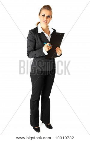 Full length portrait of attentive modern business woman with clipboard and pen