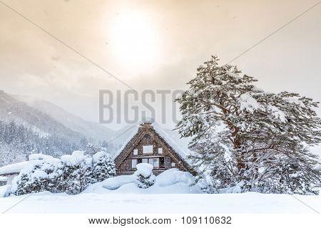 Shirakawago with Snowfall and winter Sun,  Gifu Chubu Japan
