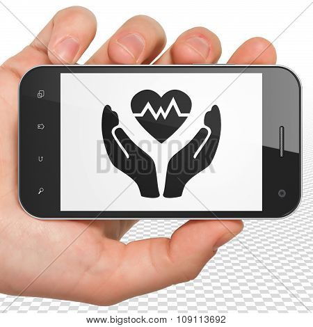 Insurance concept: Hand Holding Smartphone with Heart And Palm on display