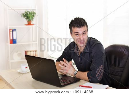 Funny Man With Laptop At Office Desk