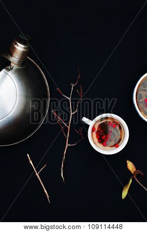 Cups of fresh herbal tea on black table. Cup of green herbal tea. Herbal tea. Botanical. Branch. Top