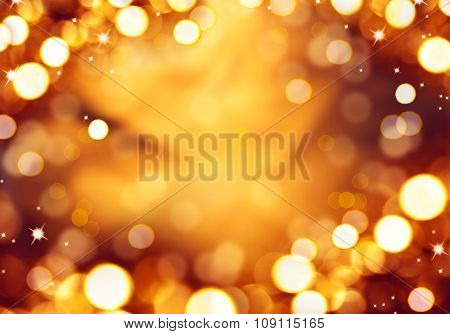 Christmas glowing Background. Golden Holiday Abstract Glitter Defocused Background With Blinking Stars. Blurred golden Bokeh