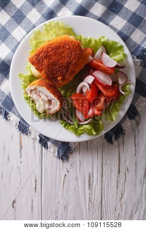 Chicken Schnitzel Cordon Bleu And A Salad. Vertical Top View