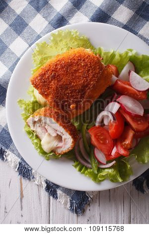 Chicken Schnitzel Cordon Bleu And A Salad Close-up. Vertical Top View
