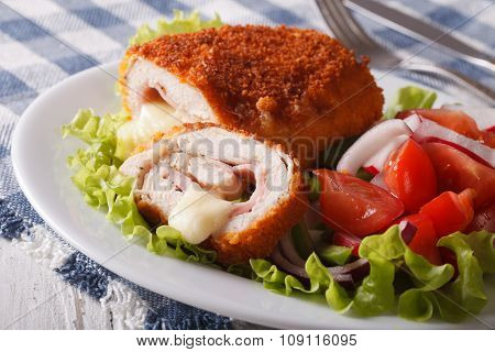 Sliced Chicken Cordon Bleu And Salad Close-up. Horizontal