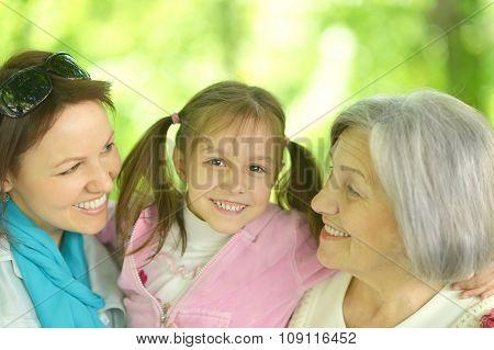 happy women with little girl