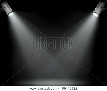 Two spotlights on black background