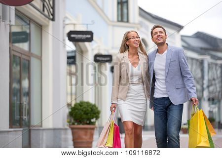 Young people with shopping bags outdoors