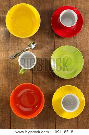 ceramic dishes set on wooden background