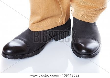 male legs in jeans and shoes on white background