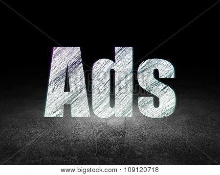 Marketing concept: Ads in grunge dark room