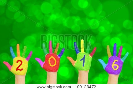 Hands Forming Number 2016 Against New Year Background.