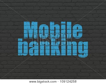 Money concept: Mobile Banking on wall background