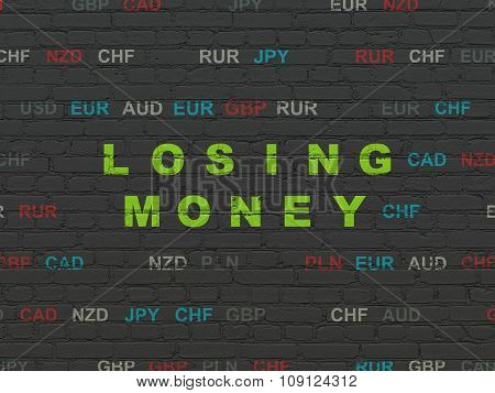 Money concept: Losing Money on wall background