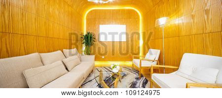 couches and background wall in  living room of villa