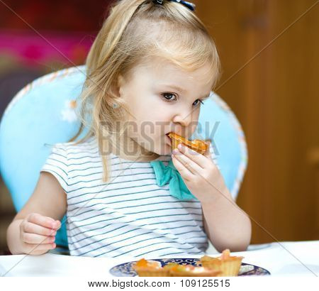 Little Girl Is Eating Cake