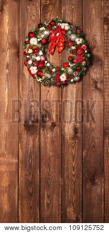 Beautiful Christmas Wreath On The Wooden Background