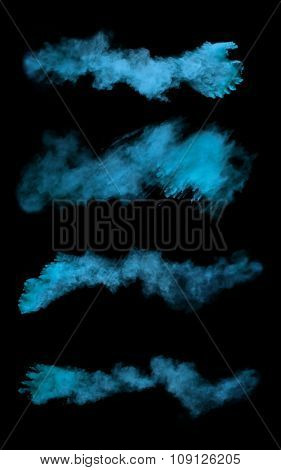 Freeze motion of blue dust explosions isolated on black background