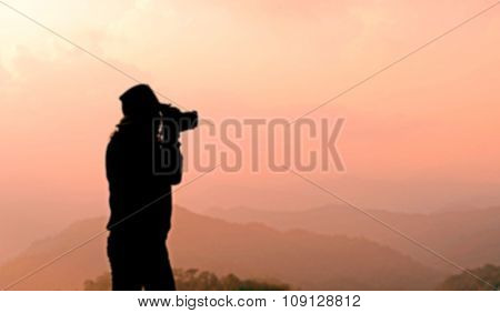 Blurry Silhouette Photographer Is Taking Photos
