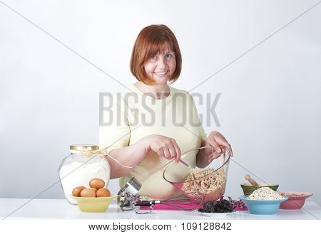 Middle-aged Woman Kneads Dough For Biscuits..