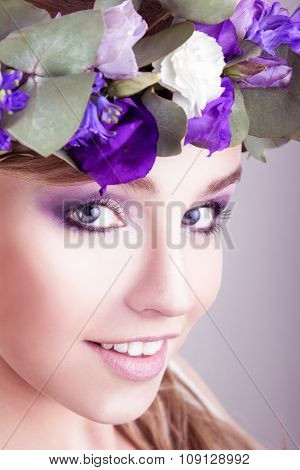 Girl with flower crown posing in studio