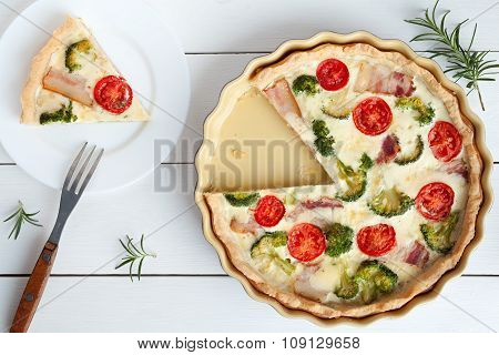 Sliced quiche lorraine tart pie traditional french food preparation recipe with tomatoes cheese baco