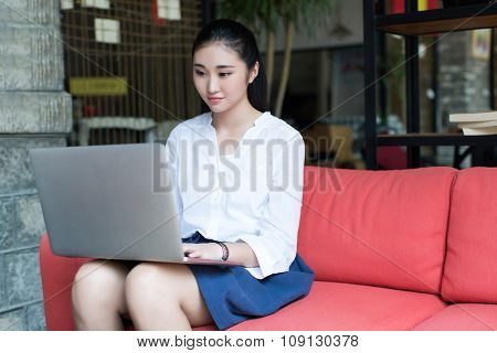 Girl Sitting On A Red Couch