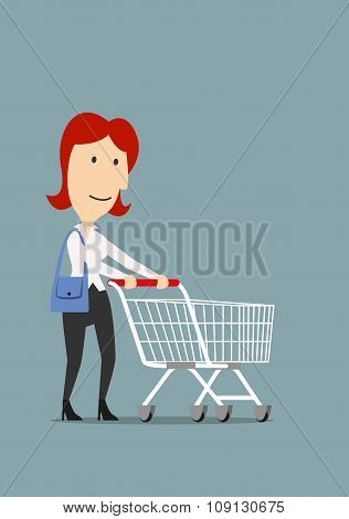 Happy businesswoman shopping with trolley cart