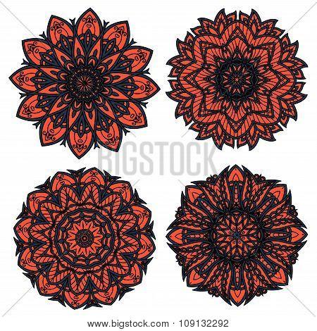 Orange and black circular floral patterns