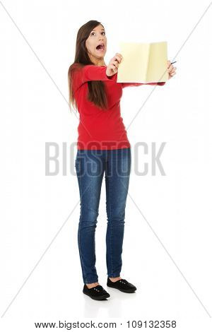 Shocked young student woman with her note.