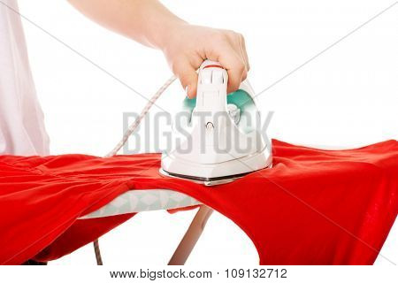 Young beautiful woman do the ironing.