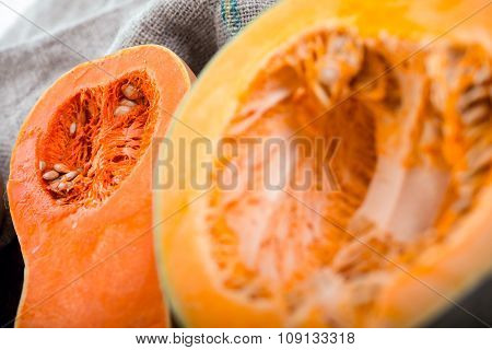 A table of autumn fruits. The fruits of autumn. Pumpkins on wooden board