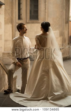 luxury romantic happy bride and groom celebrating marriage on the background of old sunny city