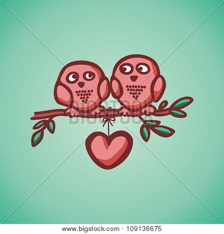 owls fall in love on the branch.