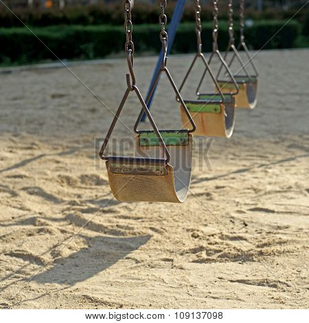 Old Chain Swings In Kids Playground