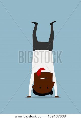 Cartoon businessman doing yoga handstand pose