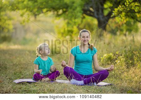 Mom and child in the lotus position